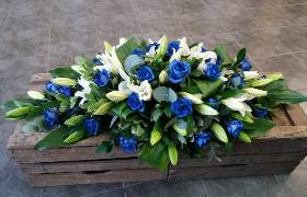 Blue and white coffin spray